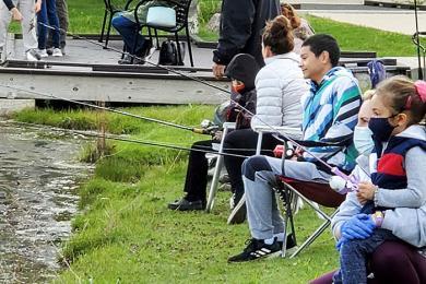Figen Kardogan and her daughter, Doga, watch their line during the fishing derby. (EC)