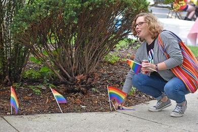 Jamie Ford of Flossmoor fixes the rainbow flags during the Pride event held in Flossmoor on Friday, June 22.