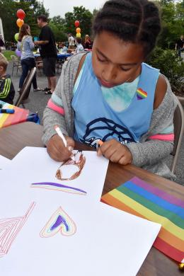 Kendra Richardson, 9, of Homewood colors a poster during the second annual Pride event held in Flossmoor.