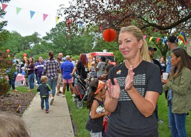 Rebecca Larsen of Flossmoor applauds the speech of Stephanie Wright during the second annual Pride Fest held in Flossmoor. Lighthouse, a pro-LGBTQ organization for youths and their families founded in April 2016 organized the event. More information about Lighthouse is atwww.lighthouselgbtq.org.