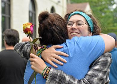 Olivia Ryan of Flossmoor gets a hug from Ariana Leonard of Homewood during the second annual Pride event in Flossmoor.