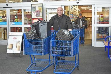 Det. Dave Freeman from Flossmoor brings out carts of toys he picked out at Meijer in Flossmoor. The toys were donated to Toys For Tots.