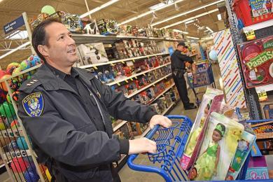 Flossmoor Police Chief Mike Pulec shops at Meijer in Flossmoor as he chooses toys for needy kids.