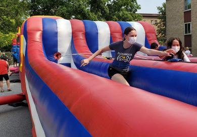 Flossmoor Fest offered a number of fun activities for kids, including this bungy bounce game. There also were bouncy obstacle courses and slides, a laser tag game, mini-golf and rides. (EC)