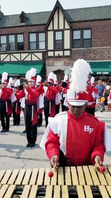 The Homewood-Flossmoor High School Marching Band helps get this year's Flossmoor Fest under way with a performance that concluded with the national anthem. (EC)