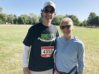 District 153 Superintendent Scott McAlister was met by District 153 School Board President Shelly Marks when he crossed the finish line. (MT)