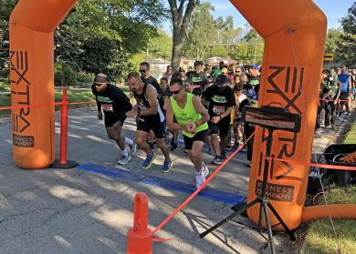 And they're off! About 250 participants, young and old, came out for the Foundation 153 Fund Run 5K run/walk to benefit Homewood schools. The winner was Bob Geiger, in green shirt, with a time of 19.02. (MT)