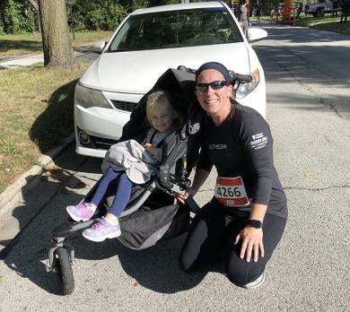 Mom Stephanie Fitch of Homewood with her running partner, Charlotte, after they finished the race. Stephanie and Charlotte, who is a pre-kindergarten student at Willow School, has been running buddies since Charlotte was six months old. (MT)