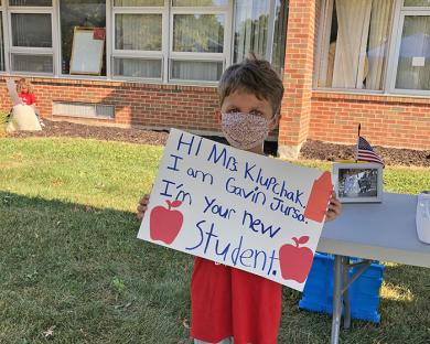 Gavin Jursa took time to make an introductory sign for his Willow School second grade teacher Michelle Klupchak.