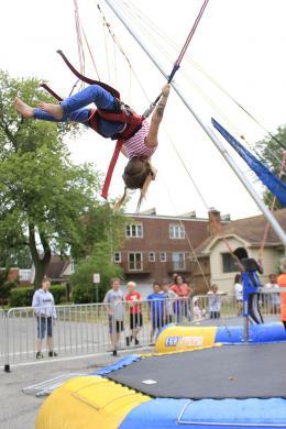 Allison Burgos of Homewood tries a back flip. (EC)