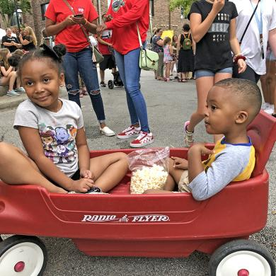 Sharing a bag of popcorn are Ava Meyers, 4, and her brother Ian, 3. The Homewood kids were at the Block Party in downtown Homewood Saturday, Aug 17. (MT)