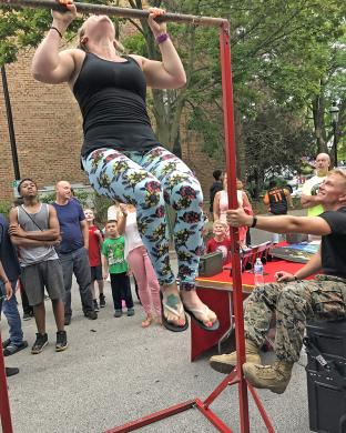 Brooke Settle of Homewood showed off her strength at the U.S. Marine Corps agility test at Homewood's Block Party Saturday, Aug. 17. (MT)