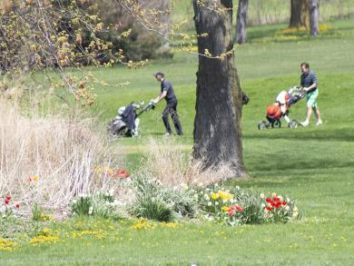 Golfers play Calumet Country Club on Friday.