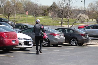 The parking lot at Coyote Run was not full but had a decent number of golfers' cars, considering the limits placed on how many golfers can play at one time.