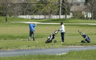A golfer tees off at Coyote Run.
