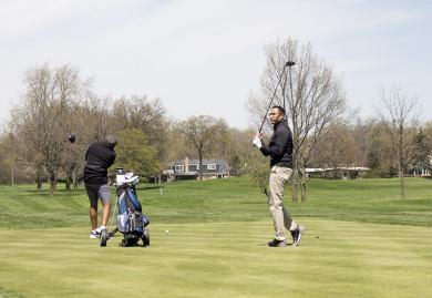 Golfers tee off at Flossmoor Golf Club.