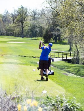 A golfer tees off at Idlewild.