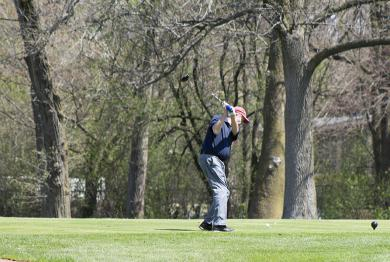 A golfer tees off at Ravisloe on Friday, the first day golfers could play after a temporary ban on the sport was lifted.