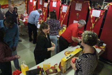 Community memberes peruse raffle items at the 2015 H-F Spain trip fundraiser Saturday.