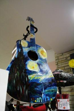 One raffle item was this guitar painted by Candi Helsel-Wilk and Kristi Weidenhoefer.