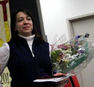 Sharon Bouchie, co-chair of the event with Shelley Peck, receives a bouquet in appreciation for her hard work.