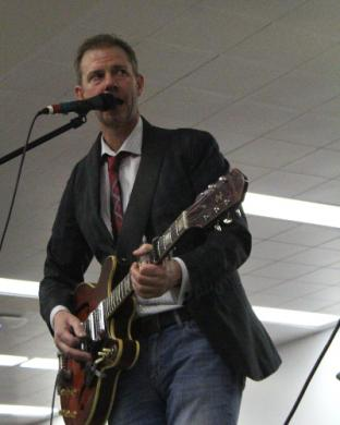 Matt Didier sings during Thing 3's set at the auction.