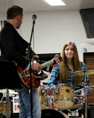 Bailey Didier takes the stage for a duet with her dad, Matt Didier.