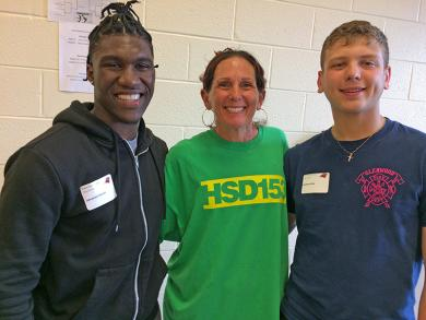 Physical education teacher Marcy Breed got to chat with Opeymi Fatuki, left, and Andrew Sline.