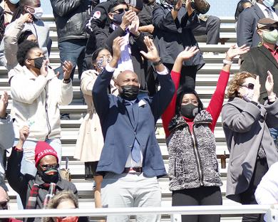 Family members cheer their graduate during the morning ceremony. (EC)