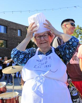 """Lillian Goodman, a Homewood resident for about 64 years, adjusts her master chef's hat. She presided over a team of family members who participated in the event. """"I think this is a terrific idea,"""" she said."""