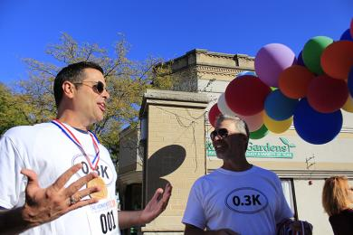 """Todd Gleason explains to race organizer Greg Loudon how he generated the willpower to go past the mid-race doughnut pitstop. """"I wanted to be the champion,"""" he said."""