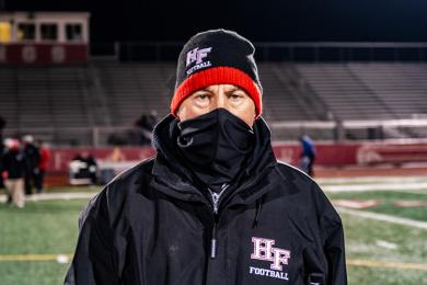 Coach Craig Buzea is masked up for the first game of his last season at the helm of the Vikings. (ABS)