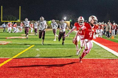 Junior Jaedyn Price (4) outruns the opposition to score a touchdown after intercepting a Lockport pass. (ABS)