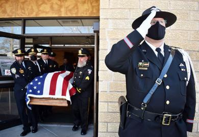 Sgt. Craig Sline from the Homewood police department salutes as the casket of Chicago Heights police officer Gary Hibbs is brought out of St. Kierens Church. A funeral was held for the Chicago Heights officer who suffered a heart attack while on a domestic call. (MC)