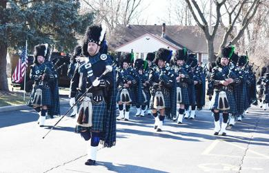 Clint Wagner, Deputy Police Chief of Flossmoor Police Department, leads the bagpipes and drums of the Emerald Society at the funeral of fallen Chicago Heights officer, Gary Hibbs. (MC)