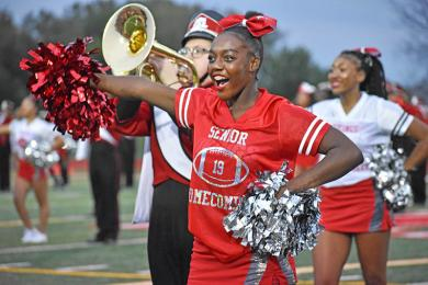 Danielle Johnson, of Homewood and a senior at H-F High, performs with the band before the homecoming game begins.