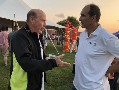 Flossmoor residents George Scully, left, and Tom Baffes in conversation at the Homewood Science Center fundraiser.
