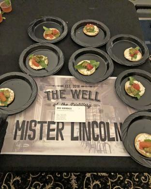 Canapes were laid out along with the drink entry from The Well, the Mr. Lincoln.
