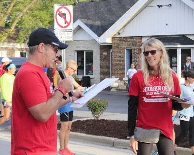 Race coordinators Sam and Betsy Cutrara brief the runners on the protocols for the race.