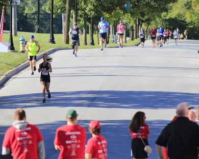 Runners head north on Sterling Avenue toward downtown Flossmoor before turning east at Flossmoor Road.