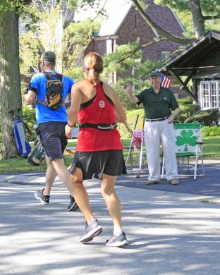 """John Beele assures runners """"it's all downhill from here."""""""