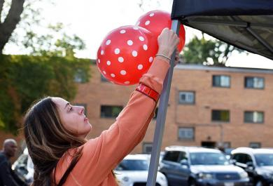 Laura O'Donnell, teacher at Infant Jesus of Prague School, begins decorating the street.