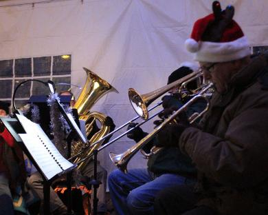 Some of the musicians with the Southwest Community Brass Ensemble had to play in gloves but they managed to bring holiday favorites to the crowd in spite of the cold