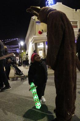Aston Bowens of Homewood greets a reindeer character during Holiday Lights.