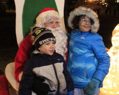Bennie and Joycelyn Cole of Homewood are the first kids to see Santa Claus at the tree-lighting ceremony in Irwin Park.