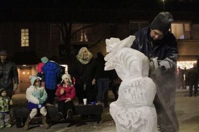 An artisan from Nadeau's Ice Sculptures puts on a sculpting demonstration on Martin Avenue.