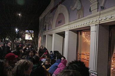 Crowds gather around the windows of the American Dance Center to watch ballet performances.