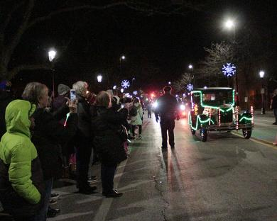 The parade of decorated antique cars approaches Irwin Park just prior to the tree lighting ceremony.