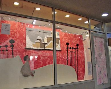 """The windows of the Triumph Building are decorated with scenes from """"A Snowy Day"""" by Ezra Jack Keats. The windows were designed by Carrie Malfeo."""
