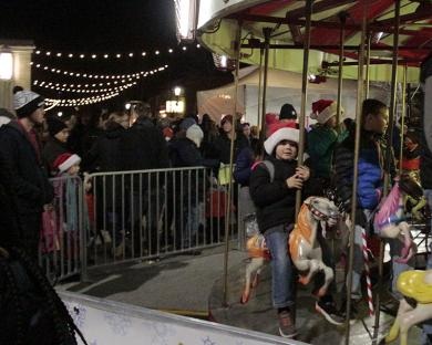 Kids and adults enjoy riding the old-fashioned carousel at Ridge and Martin during Holiday Lights.